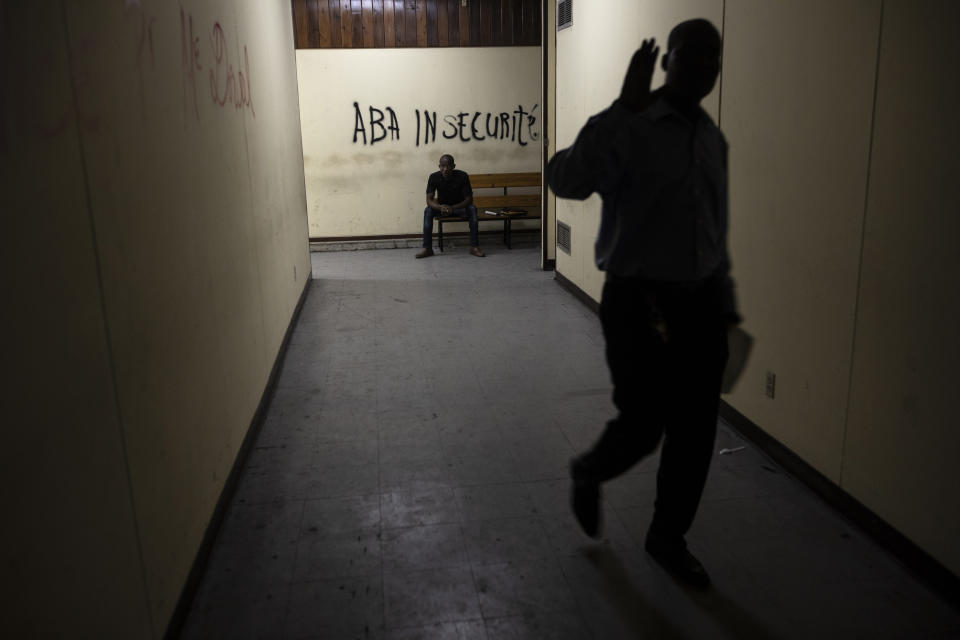 """A wall inside the Palace of Justice is spray-painted with a message that reads in Creole; """"Down with insecurity"""", in Port-au-Prince, Haiti, Thursday, Sept. 16, 2021. Even before the assassination of President Jovenel Moise in July, the government was weak -- the Palace of Justice inactive, congress disbanded by Moise and the legislative building pocked by bullets. (AP Photo/Rodrigo Abd)"""