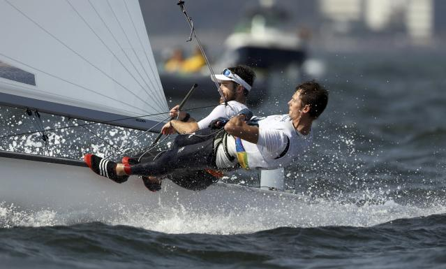 2016 Rio Olympics - Sailing - Final - Men's Two Person Dinghy - 470 - Medal Race - Marina de Gloria-Rio de Janeiro, Brazil - 18/08/2016. Luke Patience (GBR) of Britain and Chris Grube (GBR) of Britain compete. REUTERS/Benoit Tessier FOR EDITORIAL USE ONLY. NOT FOR SALE FOR MARKETING OR ADVERTISING CAMPAIGNS.