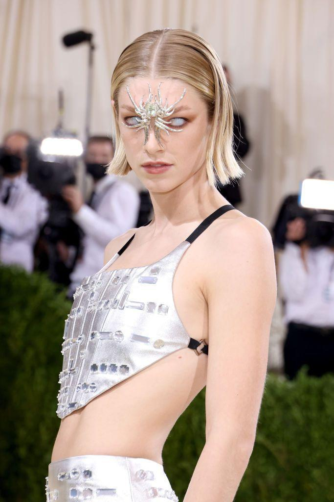 <p>The <em>Euphoria</em> alum is no stranger to standout beauty looks. For the Met Gala, Hunter stepped out in a short bob with flipped ends, white eye contacts, and a jewelry piece placed in the middle of her face. Why not?</p>