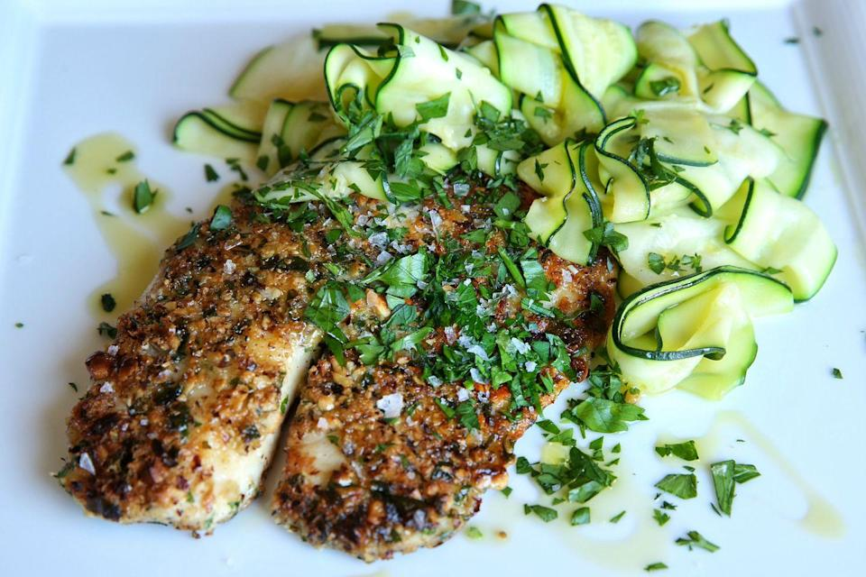 """<p>You don't need a Spiralizer to make zoodles!<br></p><p>Get the recipe from <a href=""""https://www.delish.com/cooking/recipe-ideas/recipes/a46732/hazelnut-crusted-tilapia-with-zucchini-ribbons-recipe/"""" rel=""""nofollow noopener"""" target=""""_blank"""" data-ylk=""""slk:Delish"""" class=""""link rapid-noclick-resp"""">Delish</a>.</p>"""