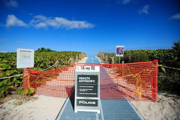 PHOTO: A beach entrance is closed off along the boardwalk in Miami Beach, Florida, on March 22, 2020. (Cliff Hawkins/Getty Images)