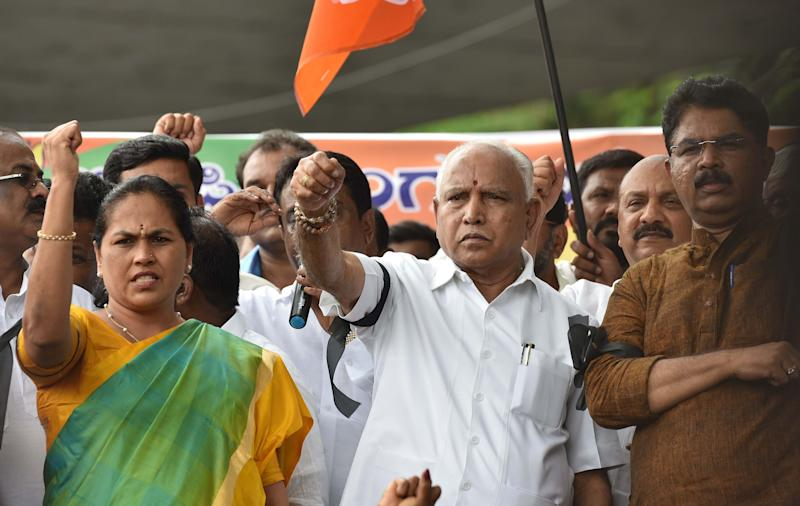 BENGALURU, INDIA - MAY 23: Karnataka BJP Chief BS Yeddyurappa along with BJP State General Secretary Shobha Karandlaje and other party supporters protests against the coalition government by Janata Dal (Secular) and Congress, ahead of swearing-in ceremony of Kumarswamy, the 24th Chief Minister of Karnataka, at Maurya Circle on May 23, 2018 in Bengaluru, India. (Photo by Arijit Sen/Hindustan Times via Getty Images)