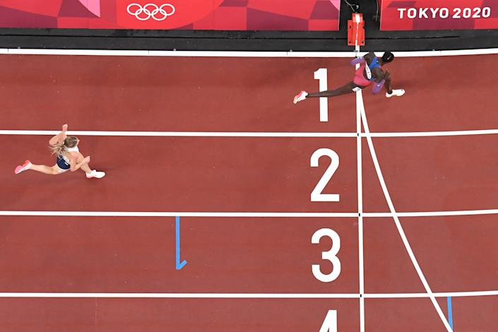 <p>TOPSHOT - An overview shows USA's Athing Mu (R) crossing the finish line to win ahead of second-placed Britain's Keely Hodgkinson (L) in the women's 800m final during the Tokyo 2020 Olympic Games at the Olympic Stadium in Tokyo on August 3, 2021. (Photo by Jewel SAMAD / AFP) (Photo by JEWEL SAMAD/AFP via Getty Images)</p>