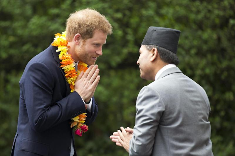 Visit: Prince Harry receives a traditional welcome: Getty Images