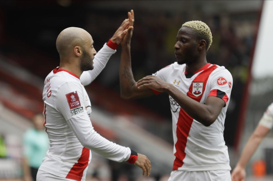 Southampton's Nathan Redmond, left, and Moussa Djenepo celebrate after scoring his side's second goal during the English FA Cup quarterfinal soccer match between Bournemouth and Southampton at Vitality Stadium in Bournemouth, England, Saturday, March 20, 2021. (AP Photo/Kirsty Wigglesworth)