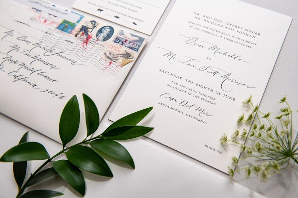 Our engraved letter press invitations with hand calligraphy and vintage stamps.