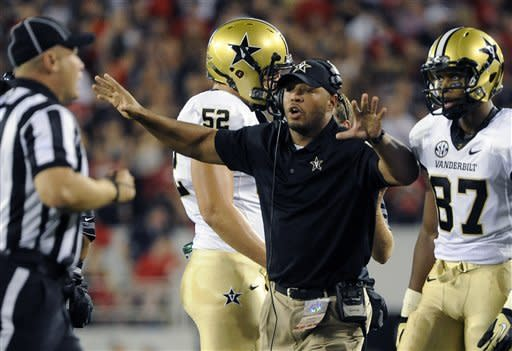 Vanderbilt head coach James Franklin, second from right, shouts to a referee during the first quarter of an NCAA college football game against Georgia, Saturday, Sept. 22, 2012, in Athens, Ga. (AP photo/John Amis)