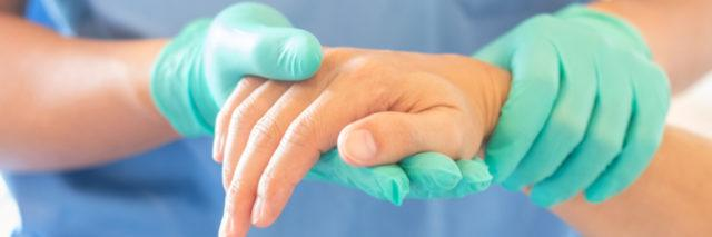Doctor holding patient's hand.