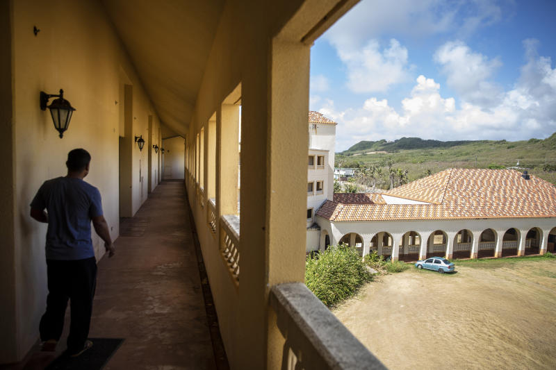 A caretaker walks through the vacant halls of the former Accion Hotel which was a seminary but is now for sale by the Catholic Church, in Yona, Guam, Wednesday, May 8, 2019. The Guam archdiocese filed for bankruptcy protection earlier this year, liquidating some of its real-estate holdings, estimating at least $45 million in liabilities. (AP Photo/David Goldman)