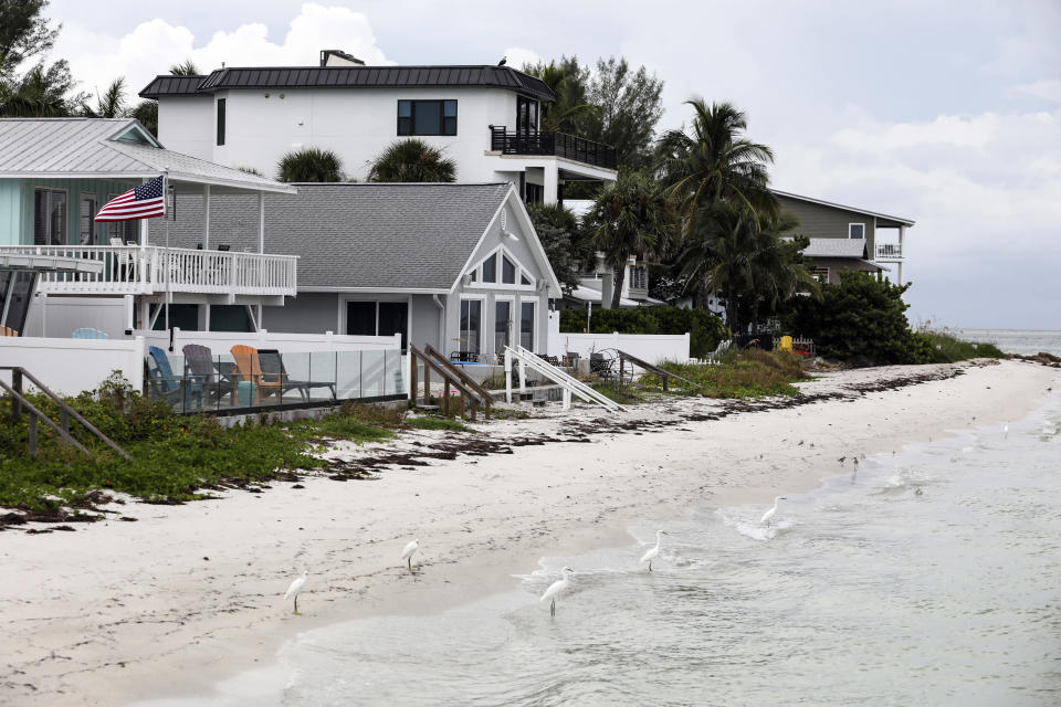 Beachfront homes in Anna Maria, Fla.; one ZIP code in the area leads the country in the number of single-family homes facing an increase of more than $1,200 for flood insurance. (Eve Edelheit/The New York Times)