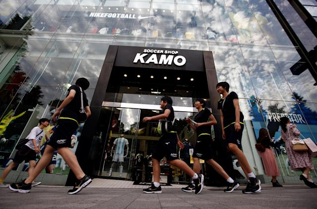 People walk past soccer shop KAMO in Tokyo, Japan May 17, 2018. REUTERS/Kim Kyung-Hoon