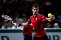 Novak Djokovic of Serbia returns a shot during his men's singles tennis match against Gael Monfils of France in the third round of the Paris Masters tennis tournament at the Bercy sports hall in Paris, October 30, 2014. REUTERS/Benoit Tessier