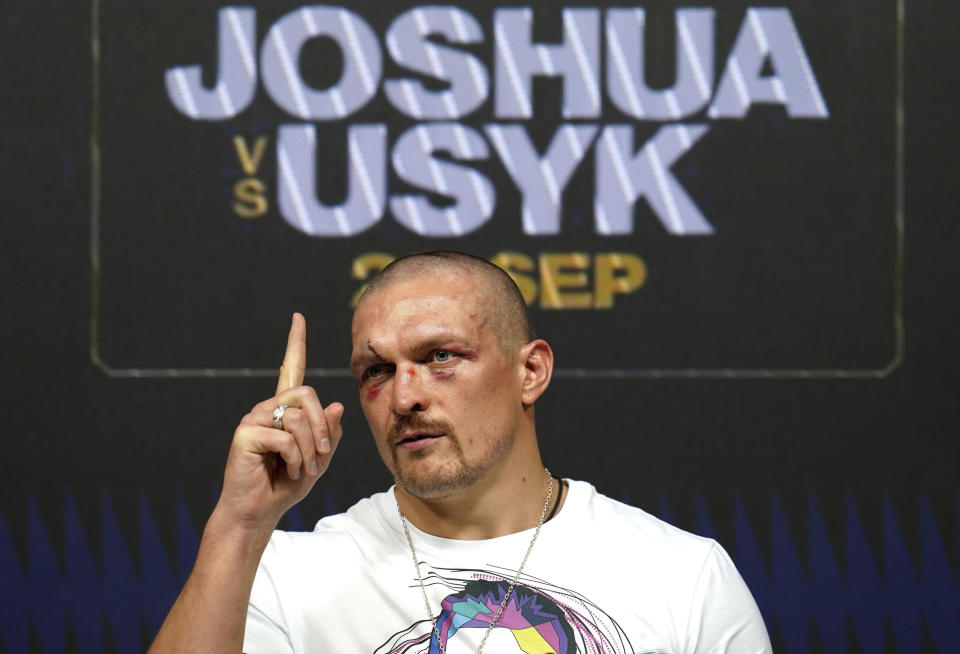 Oleksandr Usyk of Ukraine gestures during a press conference after winning the WBA (Super), WBO and IBF boxing title bout against Anthony Joshua of Britain at the Tottenham Hotspur Stadium in London Saturday Sept. 25, 2021. (Nick Potts/PA via AP)