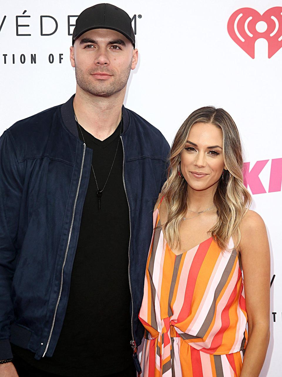 """<p>During an appearance on <em>Bachelor</em> alum Olivia Caridi's <i>Mouthing Off </i>podcast in September 2017, Kramer said that Caussin was """"<a href=""""https://people.com/country/jana-kramer-mike-caussin-actively-working-marriage/"""" rel=""""nofollow noopener"""" target=""""_blank"""" data-ylk=""""slk:still my husband, yes"""" class=""""link rapid-noclick-resp"""">still my husband, yes</a>.""""</p> <p>""""Everyone is like, 'Oh, your estranged husband' because we're technically separated,'"""" she said. """"We didn't separate in the court.""""</p> <p>After Caussin left rehab, Kramer said they focused on """"actively working"""" through their issues.</p> <p>""""I'm just <a href=""""https://people.com/babies/jana-kramer-fathers-day-mike-caussin-jolie/"""" rel=""""nofollow noopener"""" target=""""_blank"""" data-ylk=""""slk:focusing on our family"""" class=""""link rapid-noclick-resp"""">focusing on our family</a> and trying to figure it out,"""" Kramer said. """"It's day-by-day. We're not divorced, he's not my estranged husband, [and] he's very much in my life.""""</p> <p>""""Legally, he is my husband,"""" she continued. """"I have a ring on my finger. It's hard, every day — some days I'm like, 'I can't do this' … But other days I'm like, 'No, fight for it. It's for our family.' Cause I've given up so easily in the past before, so I really want to sit in the trenches and fight for it.""""</p>"""