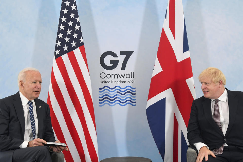 US President Joe Biden, left, talks with Britain's Prime Minister Boris Johnson, during their meeting ahead of the G7 summit in Cornwall, Britain, Thursday June 10, 2021. (Toby Melville/Pool Photo via AP)
