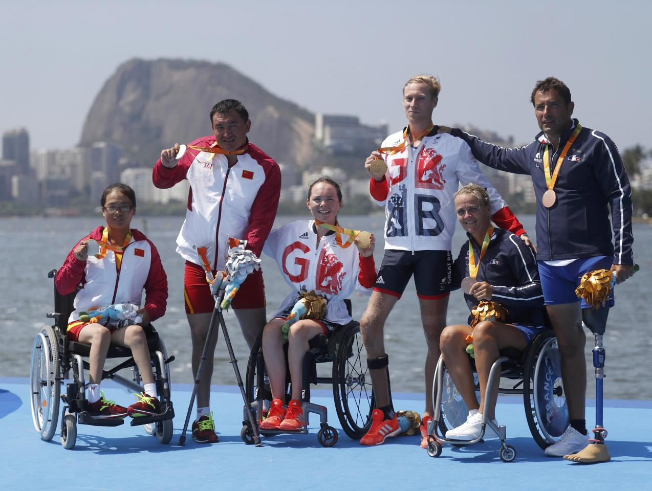 2016 Rio Paralympics - Rowing- Victory Ceremony - TA Mixed Double Scull TAMIX2X Victory Ceremony - Lagoa Stadium - Rio de Janeiro, Brazil - 11/09/2016. Silver medalists Shuang Liu and Tianming Fei of China (L to R), gold medalists Lauren Rowles and Laurence Whiteley of Britain and bronze medalists Perle Bouge and Stephane Tardieu of France pose with their medals. REUTERS/Ricardo Moraes   FOR EDITORIAL USE ONLY. NOT FOR SALE FOR MARKETING OR ADVERTISING CAMPAIGNS.