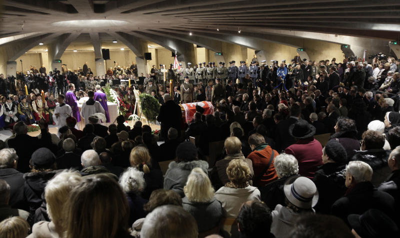 The funeral ceremony of Poland's last president-in-exile, Ryszard Kaczorowski, during his repeat burial at the Temple of God's Providence in Warsaw, Poland, on Saturday, Nov. 3, 2012. A repeat burial was ordered after forensic experts said last week that Kaczorowski's body was wrongly identified and buried in the wrong grave following the 2010 plane crash in Russia that killed 96 people, after military prosecutors still working on the crash had doubts about the identification. (AP Photo/Czarek Sokolowski)