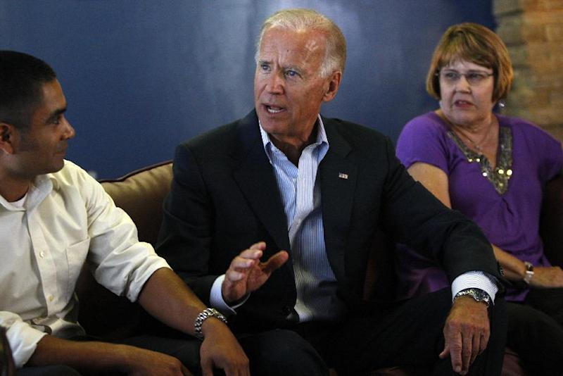Vice President Joe Biden speaks with Luis de la Cruz of Schertz, of Texas, left, and Carolyn Gigerich, of Indianapolis, right, at a coffee shop Monday, August 13, 2012, following a rally in Durham, N.C. (AP Photo/The News & Observer, Travis Long) MANDATORY CREDIT