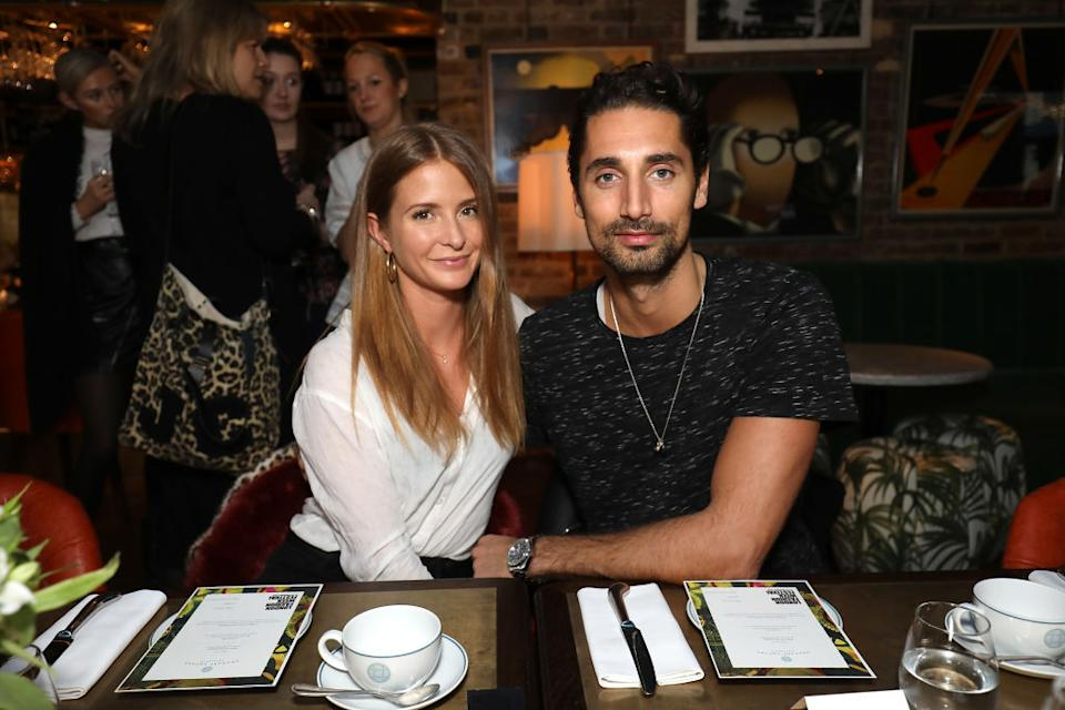 Millie Mackintosh and husband Hugo Taylor are thinking of taking their baby daughter on her first trip abroad, pictured at LFW in January 2018. (Getty Images)