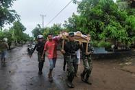 Indonesia's disaster management agency said it had recorded 86 deaths in a cluster of remote islands near East Timor, where another 34 have been officially listed as dead