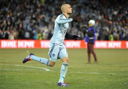 Dec 7, 2013; Kansas City, KS, USA; Sporting KC defender Aurelien Collin (78) celebrates after scoring a goal against the Real Salt Lake during the penalty kick shootout in the 2013 MLS Cup at Sporting Park. Mandatory Credit: Denny Medley-USA TODAY Sports