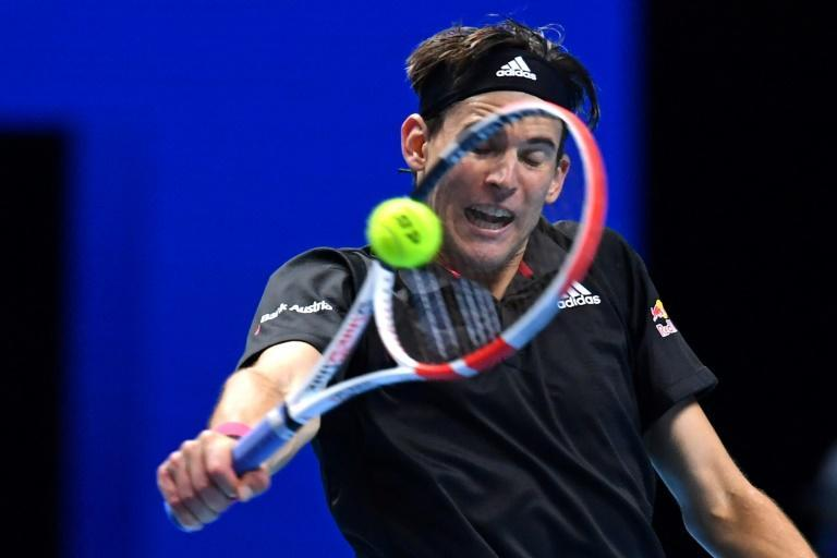 Dominic Thiem in action against Stefanos Tsitsipas on the first day of the ATP Finals in London