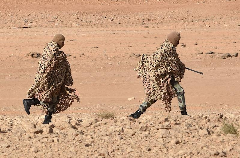 """Saudi special forces snipers run before taking a position during """"anti-terrorist"""" exercises on March 18, 2015"""
