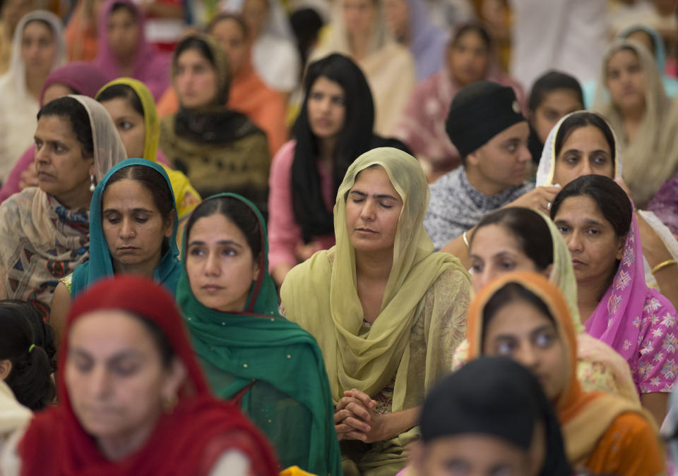 People attend a prayer service at the Sikh Temple of Wisconsin in Oak Creek, Wis., Sunday, Aug. 12, 2012. More than 100 people gathered for the first Sunday prayer service since a white supremacist shot and killed six people there before fatally shooting himself. (AP Photo/Jeffrey Phelps)
