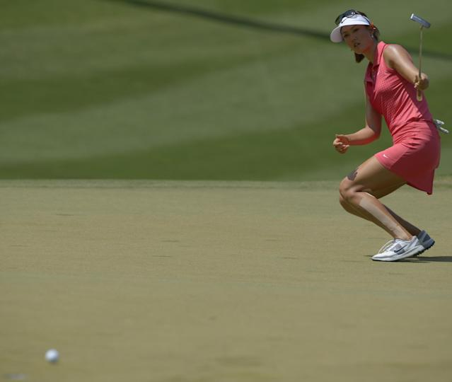 Michelle Wie tries to steer her putt on the tenth hole in the final round of the Airbus LPGA Classic golf tournament at Magnolia Grove on Sunday, May 25, 2014, in Mobile, Ala. (AP Photo/G.M. Andrews)