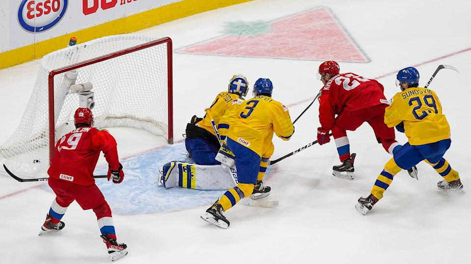Marat Khusnutdinov of Russia scores the game-winning goal against goaltender Jesper Wallstedt of Sweden at the world juniors. (Photo by Codie McLachlan/Getty Images)