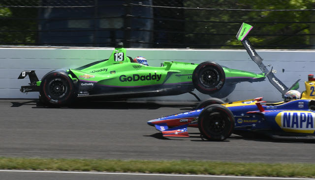 Alexander Rossi drives by Danica Patrick as she hits the wall in the second turn during the running of the Indianapolis 500 auto race at Indianapolis Motor Speedway, in Indianapolis Sunday, May 27, 2018. (AP Photo/Greg Huey)