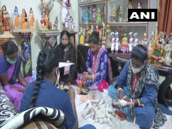 A visual of the artists making dolls. (Photo/ANI)