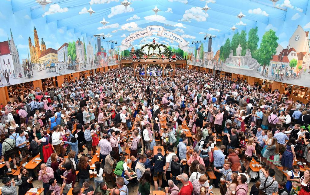 <p>Visitors celebrate in the beer tent 'Hacker-Pschorr – Himmel der Bayern' ('Bavarian heaven') at day two of the 2017 Oktoberfest beer festival in Munich, Germany. Oktoberfest is the world's largest beer celebration and typically draws over six million visitors over its three-week run. Oktoberfest includes massive beer tents, each run by a different Bavarian brewer, as well as amusement rides and activities. (Joerg Koch/Getty Images) </p>