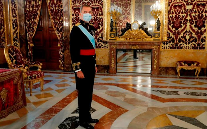 Spain's King Felipe VI wearing a face mask, attends a ceremony to present the credentials of new ambassadors in Spain at Royal Palace, in Madrid, Spain, 30 September 2020 - Chema Moya/AFP