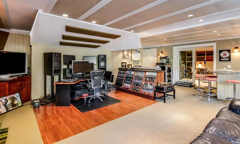 The two-story home of roughly 5,400 square feet features a lower level with a recording studio and wet bar.