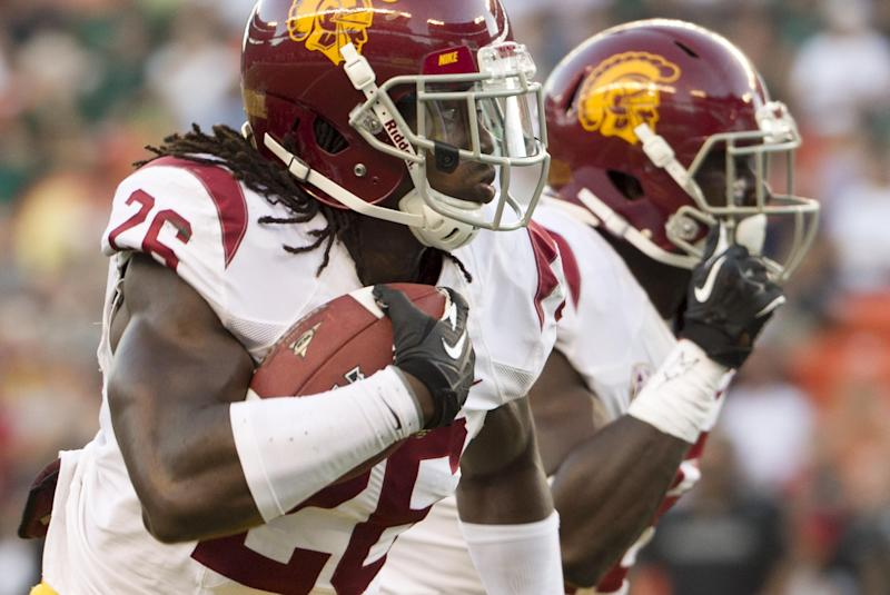 Southern California safety Josh Shaw (26) runs back an interception for a touch down against Hawaii during the second quarter of an NCAA college football game Thursday, Aug. 29, 2013, in Honolulu. (AP Photo/Eugene Tanner)