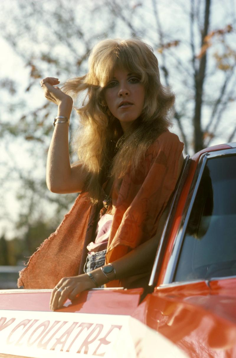 UNITED STATES - OCTOBER 01: NEW HAVEN Photo of FLEETWOOD MAC and Stevie NICKS, of Fleetwood Mac, posed with car (Photo by Fin Costello/Redferns)