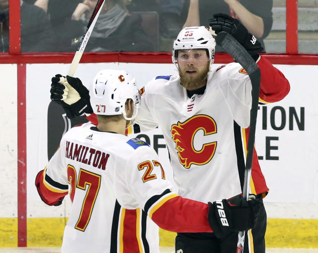 Calgary Flames center Sam Bennett (93) celebrates his goal against the Ottawa Senators with defenseman Dougie Hamilton (27) during the first period of an NHL hockey game in Ottawa, Friday, March 9 2018. (Fred Chartrand/The Canadian Press via AP)