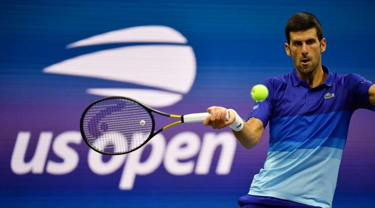 Serbia's Novak Djokovic will try to reach the fouth round of the US Open and move nearer to a calendar-year Grand Slam by defeating Kei Nishikori on Saturday (AFP/Ed JONES)