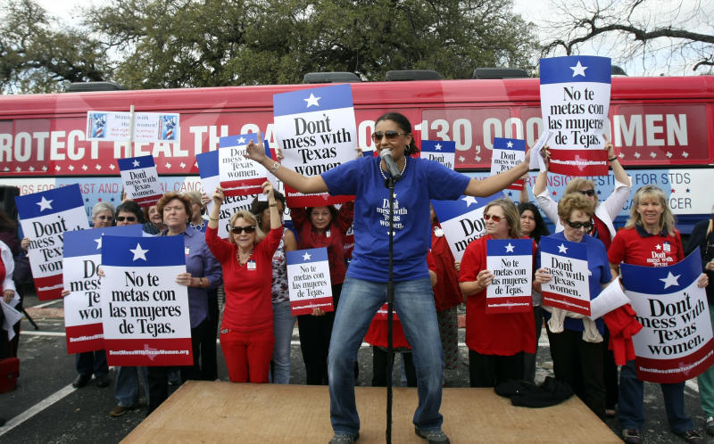 FILE - In this March 6, 2012 file photo, Carol McDonald, spokesperson for Planned Parenthood, speaks in front of a crowd of about 200 people during Women's Health Express, a bus event held to protest the attempt to cut Planned Parenthood out of Women's Health Plan in San Antonio. Texas is among several states where Republican-controlled legislatures have voted to cut off Planned Parenthood's funding. (AP Photo/The San Antonio Express-News, Helen L. Montoya, File) RUMBO DE SAN ANTONIO OUT; NO SALES