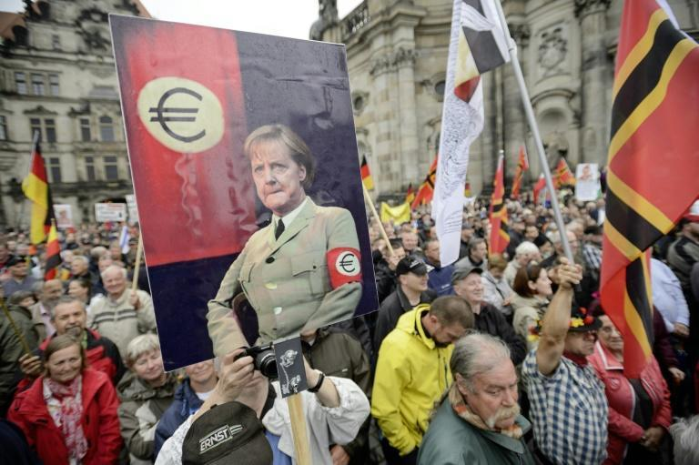 Protesters in Germany and Greece were angry over Merkel's handling of the eurozone debt crisis