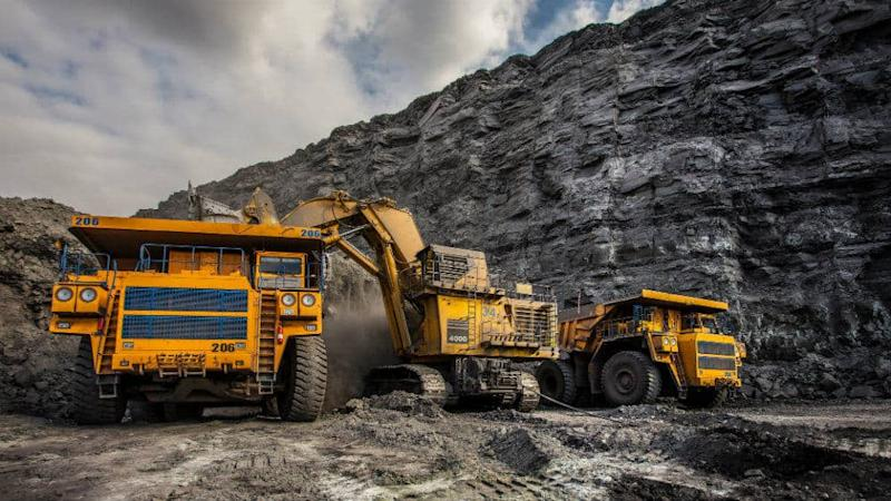 Diggers and trucks in a coal mine