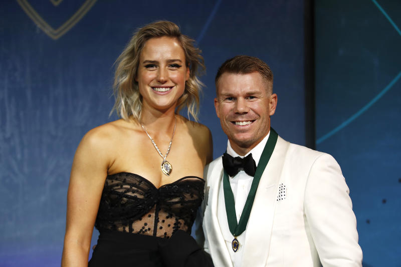 Ellyse Perry (L) winner of the Belinda Clark Award poses with David Warner, winner of the Allan Border Medal during the 2020 Cricket Australia Awards at Crown Palladium on February 10, 2020 in Melbourne, Australia. (Photo by Daniel Pockett/Getty Images)