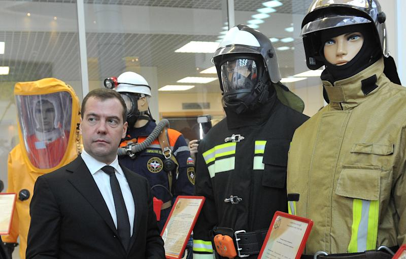 Russian Prime Minister Dmitry Medvedev, front left, visits an exhibition of rescue equipment in Krasnogorsk, outside Moscow, Wednesday, Jan. 30, 2013. (AP Photo/RIA Novosti, Alexander Astafyev, Government Press Service)