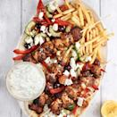 """<p>Chicken souvlaki is a classic <a href=""""https://www.delish.com/uk/food-news/a30624859/greek-food/"""" rel=""""nofollow noopener"""" target=""""_blank"""" data-ylk=""""slk:Greek"""" class=""""link rapid-noclick-resp"""">Greek</a> fast food dish that will make you feel like you're on holiday in no time. Consisting of grilled skewered pieces of meat, you eat it hot straight off the skewer and can serve it with a variety of sides - we've gone for flatbreads and chips, with <a href=""""https://www.delish.com/uk/cooking/recipes/a28839760/best-greek-salad-recipe/"""" rel=""""nofollow noopener"""" target=""""_blank"""" data-ylk=""""slk:Greek salad"""" class=""""link rapid-noclick-resp"""">Greek salad</a> and a good dollop of <a href=""""https://www.delish.com/uk/cooking/recipes/a30960236/authentic-tzatziki-recipe/"""" rel=""""nofollow noopener"""" target=""""_blank"""" data-ylk=""""slk:tzatziki"""" class=""""link rapid-noclick-resp"""">tzatziki</a>. </p><p>Get the <a href=""""https://www.delish.com/uk/cooking/recipes/a35901474/chicken-souvlaki/"""" rel=""""nofollow noopener"""" target=""""_blank"""" data-ylk=""""slk:Chicken Souvlaki Skewers"""" class=""""link rapid-noclick-resp"""">Chicken Souvlaki Skewers</a> recipe. </p>"""