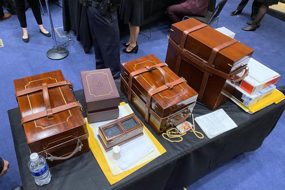 In this photo released by the Office of U.S. Sen. Jeff Merkley, D-Ore, Electoral College ballots sit on a table after they were rescued from the Senate floor in Washington, Wednesday, Jan. 6, 2020. (Office of U.S. Senator Jeff Merkley via AP)