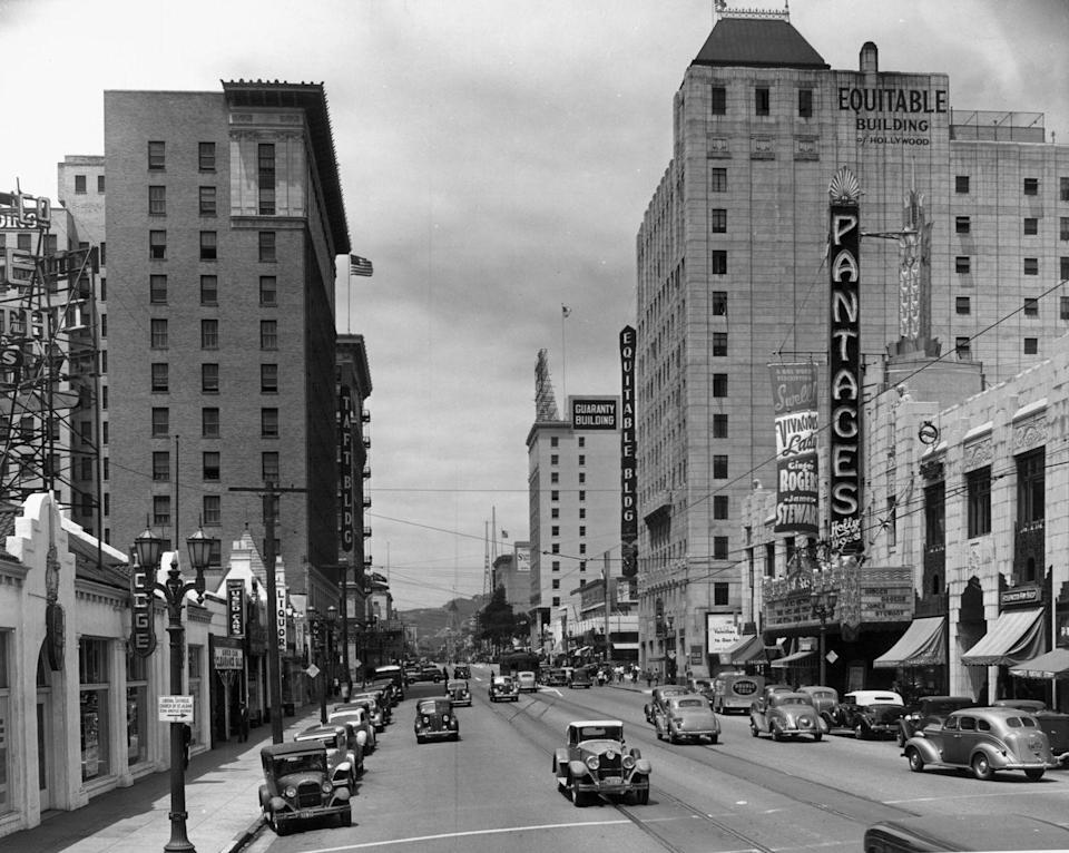 "<p>The Pantages Theatre can be seen looking down Hollywood Boulevard. It's endearingly nicknamed ""Broadway in Hollywood."" </p>"
