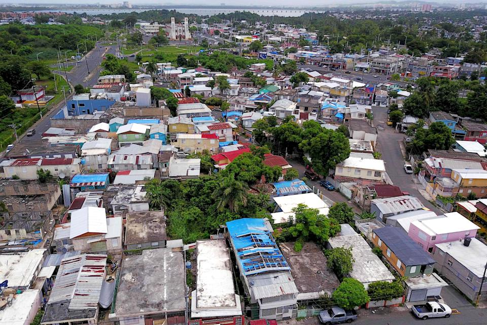Image: Blue tarps given out by FEMA cover several roofs two years after Hurricane Maria affected the island in San Juan, Puerto Rico, on Sept. 18, 2019. (Ricardo Arduengo / AFP - Getty Images file)