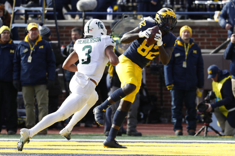 Michigan tight end Nick Eubanks (82) catches a 5-yard touchdown pass as Michigan State safety Xavier Henderson (3) defends in the first half of an NCAA college football game in Ann Arbor, Mich., Saturday, Nov. 16, 2019. (AP Photo/Paul Sancya)