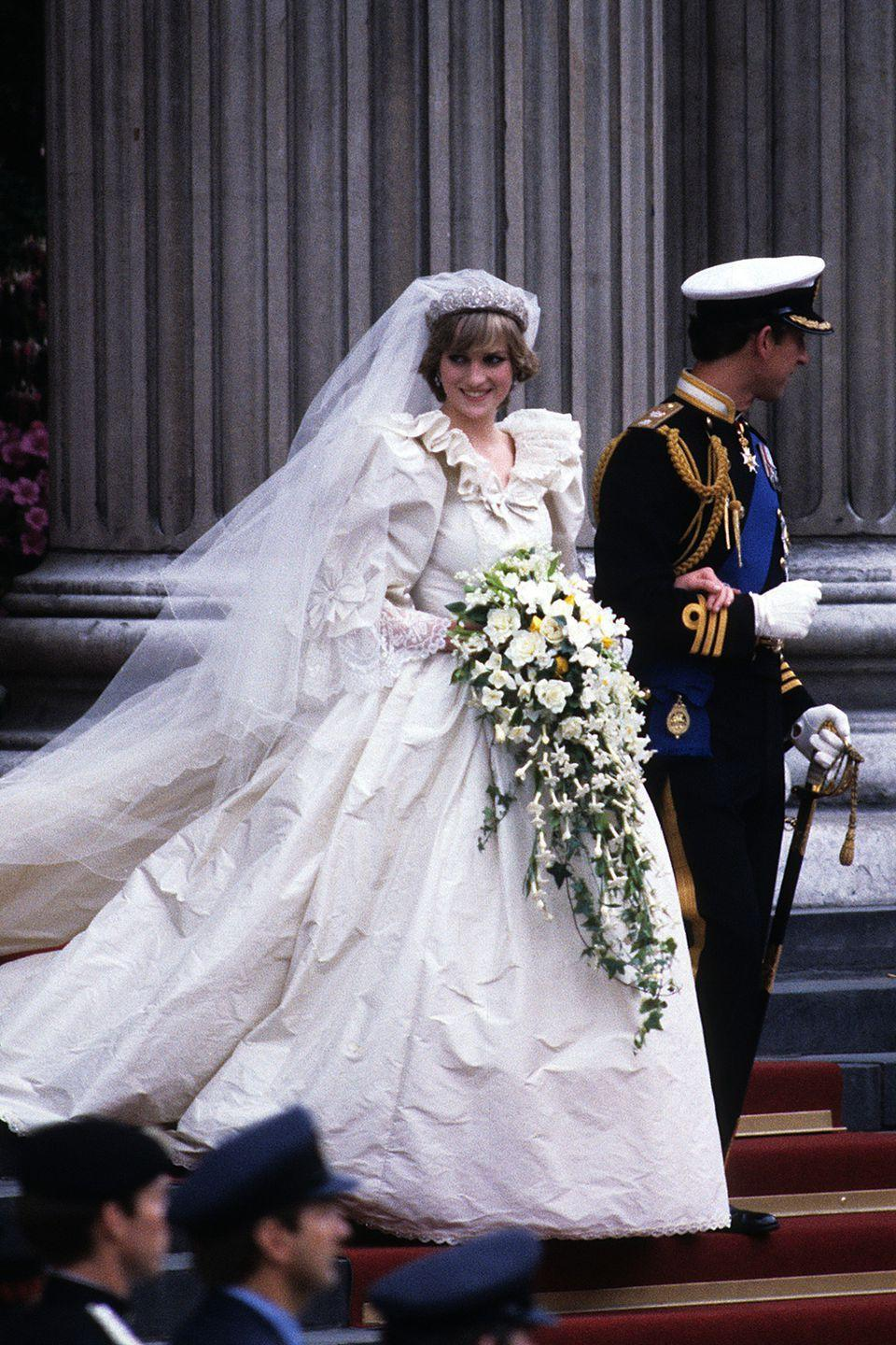 <p>The people's princess set the bar for dramatic wedding dresses when she wed Prince Charles at St Paul's Cathedral in a voluminous dress by David Emanuel. The design was so secretive that Emanuel made a second dress just in case the first one was leaked.</p>
